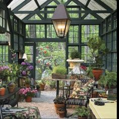 A super cool sunroom/greenhouse! I'd love to have this.