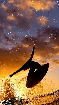 Surfing at sunset. #MeetTheMoment