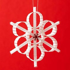 Circle Snowflake Ornament. Hold punched border strips together in snowflake circles with white chenille stems. Add a red snowflake to the center for a pop color