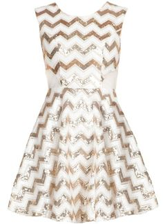 Chevron Shocker Dress: Features a brilliant white foundation with glittering gold chevron lines throughout, cute white mesh insets on each side, cutout open back crowned with a double button closure, and a super girly fit-and-flare skirt to finish.
