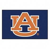 Support your favorite sports team, the Auburn Tigers, at home, or in the office by hanging up this outdoor banner flag. The Auburn Tigers officially licensed banner shows your team spirit with vibrant team colors. The College logo is cent. Auburn Tigers, Living Room Carpet, Rugs In Living Room, College Football, Auburn Football, Alabama Football, Football Team, Man Cave Area Rugs, Star Rug