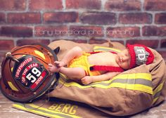 firefighter baby.  PS any one of my friends (casey's friends) that want to knit or crochet two hats like this for my boys Go right ahead!!  I LOVE THAT HAT