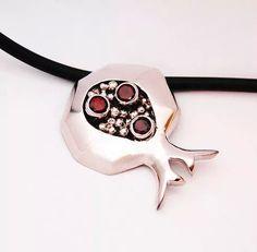 Modern silver design pendant with granate gemstones. #pendant #handcrafted #silver #handmade #goldsmith #silversmith #jewellery #jewelry #designer #Design #jewellerydesign