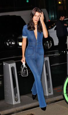 efc7d72092c Bella Hadid ditches her bra as she attends Victoria s Secret fitting in  plunging jumpsuit