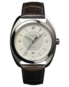 Hermès Dressage Havaine watch $8050 with brown alligator strap; was the proper size on; could give or take chrono