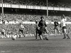20th August 1966, Spurs winger Jimmy Robertson shoots past goalkeeper Gary Sprake and defender Paul Reaney Leeds lost 1-3.