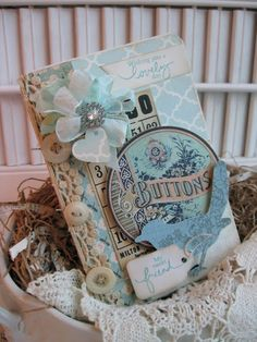 Vintage-themed buttons and bird friendship card, embellished with buttons, lace, ribbon, chipboard pieces