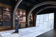 Immersive Drawing Board A continuous floor to wall projected environment which uses motion tracking cameras and specially developed software to enable visitors to physically trigger a series of animated films and games based on the production drawings of the ship.