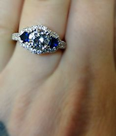 Diamond & Sapphire Engagement Ring....i'm speechless. that is really pretty. like really pretty.