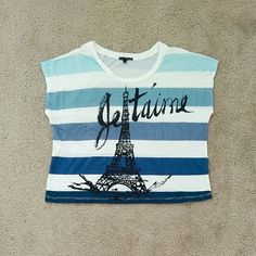 NWOT Truly madly deeply Paris striped cropped tee New without tag.  Size small.  Bought from Urban Outfitters.  Stripes in different blue, with Eiffel tower graphic design in the front. Urban Outfitters Tops