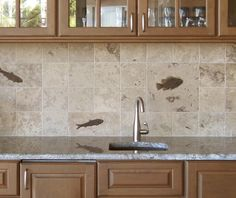 In a perfect world.... THIS would be my back-splash.    Honed 4x4 field tiles with 4x8 and 8x8 fossil tiles. Fish prepared in relief.