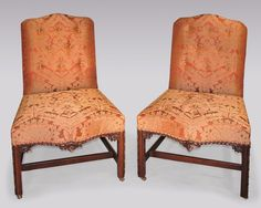 A fine pair of mid 18th Century Chippendale period mahogany Side Chairs with serpentine backs & seats, having stuffover seats with boldly carved decoration, supported on carved square legs with stretchers. Circa: 1760 Ref: 4662