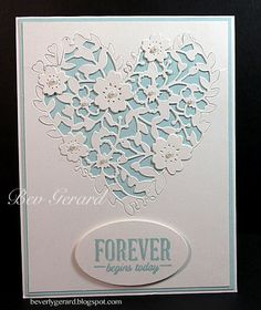 Bloomin' Hearts Thinlits cut on white shimmering paper creates a an elegant wedding card. Layer it over Blue Sky and add some blossom cuts.  DIY wedding card.