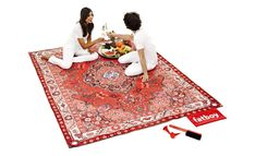 This is a picnic blanket that looks like an Oriental rug, because you're fancy.