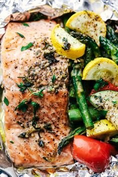 Butter Garlic Herb Salmon Foil Packets are made with tender and flaky salmon with fresh summer veggies.  They cook to perfection and will become a favorite! #MyRecipeMagic salmon #packets #dinner #easy