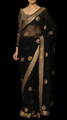 A black color sari with zardozi embroidery and a matching stitched blouse<br />