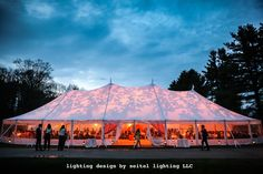 An Aztec Tidewater sailcloth tent illuminated with abstract breakup gobos in ambers, yellows and oranges for a tent wedding at The Mount. Lighting design by Seitel Lighting LLC. Wedding Tent Lighting, Event Lighting, Tent Wedding, Outdoor Wedding Venues, Lighting Ideas, Lighting Design, Lenox Massachusetts, Massachusetts Wedding Venues, Boston Wedding Venues