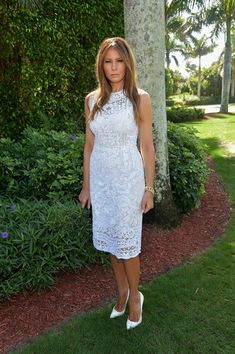 Melania Trump was elegant wearing a lace white midi dress pair with white heels at the Trump Invitational Grand Prix Mar-a-Lago Club event.
