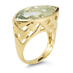 This 14k yellow gold ring features a radiant green quartz stone.