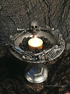How's this for some fun Halloween DIY decor? Get thee to the Dollar Store and make one yourself! You'll need a plastic skeleton with...