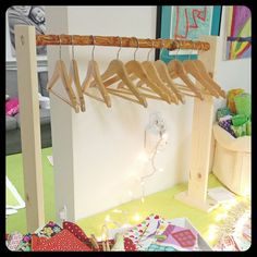 Easy branch rack for our craft show booth setup (table top). This is a mini one that holds small children's hangers Craft Stall Display, Market Stall Display, Vendor Displays, Craft Booth Displays, Display Ideas, Vendor Booth, Booth Ideas, Craft Show Booths, Market Displays