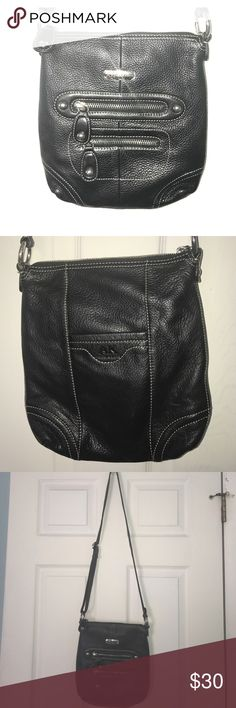 Anne Klein cross body bag Anne Klein cross body bag in black  with 2 zippered and 1 envelope outside pockets. Zippered top, adjustable strap and pockets inside Anne Klein Bags Crossbody Bags