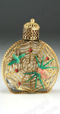 c.1930s SPIDER  FLY CAGED CLEAR GLASS SCENT BOTTLE WITH YELLOW METAL SCREW TOP, CZECHOSLKOVAKIAN. To visit my website click here: http://www.richardhoppe.co.uk or for help or information email us here: info@richardhoppe.co.uk