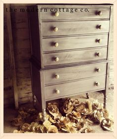 Silver dresser painted by Alison of The Modern Cottage Company paint silver acrylic Martha Stewart dry bushed layers.
