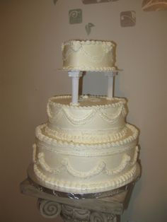draping wedding cake before the flowers