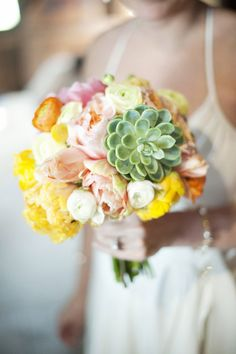 Gorgeous bouquet at this barn wedding with vintage travel theme - Justin and Mary Photography via JunebugWeddings.com