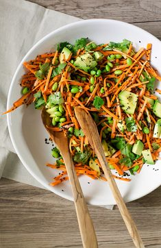 Crunchy, colourful ginger, citrus and black sesame carrot salad with edamame.