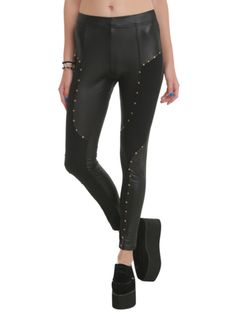 Black leggings with shiny finish and gold tone star & stud details.