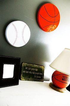 Stove burner covers spray painted to become sports magnetic boards.