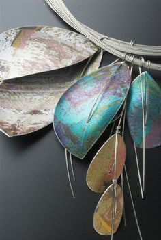 """Necklace (Detail)    Jane Adam. """"Leaf Pendants"""" Dyed anodised aluminium with stainless steel wire and stainless steel cables"""