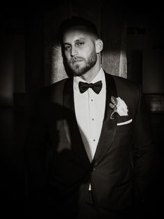 Black and white portrait of groom; Liberty Warehouse wedding in Brooklyn NY; PHOTOGRAPHY by Joel + Justyna Bedford
