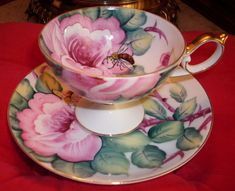 This is a Saji Fancy China cup and saucer featuring hand painted lush pink roses and a bee collecting nectar, pat. The handle was designed to give plenty of space between the cup and the main body. China Cups And Saucers, Teapots And Cups, Teacups, Vintage Cups, Vintage Tea, Cup And Saucer Set, Tea Cup Saucer, Fancy Tea Cups, Tea Places