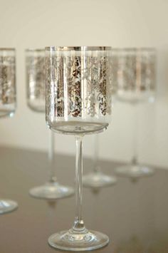 Stemmed glasses with silver overlay pattern
