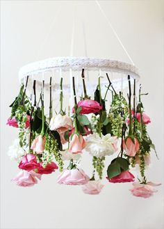 Floral chandelier. 15 Wedding DIY Projects for Under $50 #weddingchicks http://www.weddingchicks.com/15-popular-diy-projects-50/
