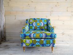 lub chair reupholstered in a vibrant turquoise and lemon African wax print