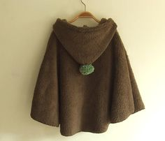 cape with pompom  circle poncho with pixie hood and simple placket. my daughter loves it!