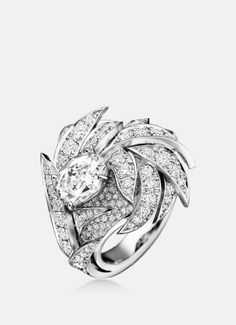Plumes ring set with one oval-cut diamond and diamond pave in 18k white gold by…