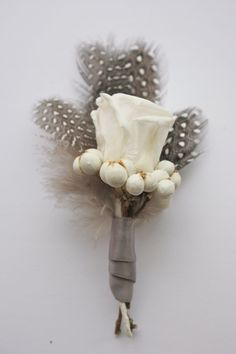 Patti - love everything about this one and am excited about how can mix tiny feathers into the bride/groom pieces.  Feathered Rose Boutonniere by FayeMarie on Etsy, $12.00