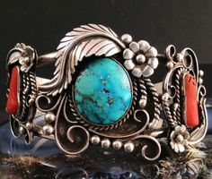 Cuff | Artist unknown.  Sterling silver, coral and turquoise.  ca. 1975