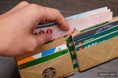 Looking for a quick custom wallet? Well, if you've got a paper bag lying around, then you can get started on your own paper bag origami wallet with this tutorial. Origami Wallet, Diy Wallet Paper, Diy Wallet Cardboard, Tyvek Wallet, Furoshiki, Papier Diy, Starbucks Logo, Starbucks Products, Starbucks Coffee