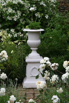 This urn and plinth needs to weather-down a bit as it's too white for the English light ...