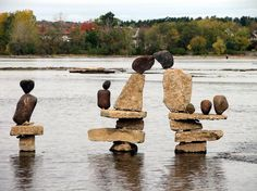Ottawa River Rock Sculptures - by John Ceprano.  No mortar of any kind is used in the process. Each rock balances on its perch assisted by small stone shims, which he picks up from the site along with the rest of his stone materials.