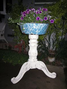 Plant stand made from a table base and vintage granite ware bowl