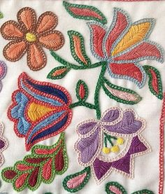 Supposedly Hungarian . . . really neat combo of stitches. Ladder/square chain stitch for outlining and fishbone? for filling.: