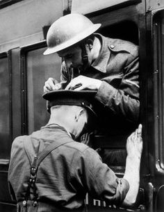 This soldier acting as a desk for his friend:   18 WWII-Era Photos To Make You…