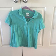 Teal Lacoste Polo Real Lacoste polo size #46 about a size large.  Top is a bit short fitting at the bottom.  From a smoke free home! Lacoste Tops